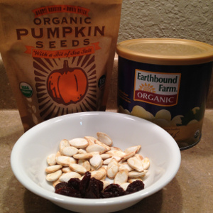14g pumpkin seeds + 10g raisins = 94 calories